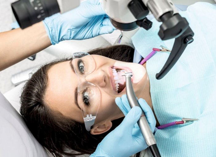 Как проводится лечение зубов под микроскопом